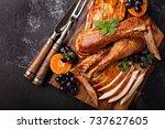 Carved Turkey On A Cutting...