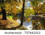 autumn in the city park of riga | Shutterstock . vector #737662312