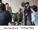 Small photo of multicultural group of businesspeople discussing business strategy