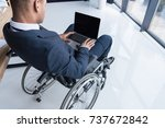 cropped shot of disabled... | Shutterstock . vector #737672842