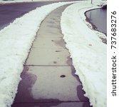 Snowy Icy Sidewalk.