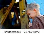 a little boy looks into the...   Shutterstock . vector #737697892