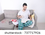 attractive young man studying...   Shutterstock . vector #737717926