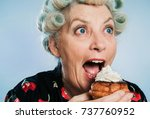 senior woman with rollers in... | Shutterstock . vector #737760952