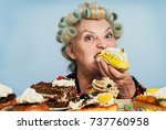 senior woman with rollers in... | Shutterstock . vector #737760958