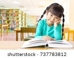 asian kid enjoy reading in the... | Shutterstock . vector #737783812
