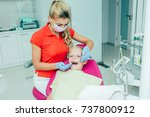 a child at the dental clinic | Shutterstock . vector #737800912