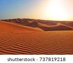 the sunset in the desert. dunes ... | Shutterstock . vector #737819218