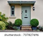 front door and porch of an... | Shutterstock . vector #737827696