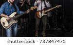 rock band performs on stage.... | Shutterstock . vector #737847475