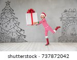 happy child in christmas time.... | Shutterstock . vector #737872042
