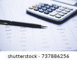 calculator and pen  on document ... | Shutterstock . vector #737886256