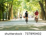 biking in the vondelpark in... | Shutterstock . vector #737890402