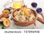 bowl with oatmeal  fresh plums... | Shutterstock . vector #737896948