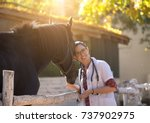 pretty young veterinarian... | Shutterstock . vector #737902975