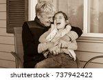 happy grandmother hug  her cute ... | Shutterstock . vector #737942422