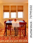 Dining room with folk design, warm yellow and red colors. Old craftsman style home in Seattle. - stock photo