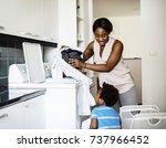 mom doing the laundry | Shutterstock . vector #737966452