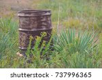 old rusty metal barrel | Shutterstock . vector #737996365