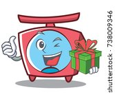 with gift scale character... | Shutterstock .eps vector #738009346