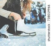 woman tie shoelaces at figure... | Shutterstock . vector #738019966