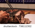 a roast leg of lamb with... | Shutterstock . vector #738111502