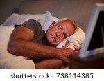 sad senior man lying in bed... | Shutterstock . vector #738114385