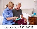 nurse helping senior man to...   Shutterstock . vector #738116392