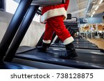 santa claus in the gym doing...   Shutterstock . vector #738128875