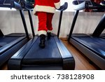 santa claus in the gym doing...   Shutterstock . vector #738128908