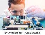 the asian technician is putting ... | Shutterstock . vector #738130366