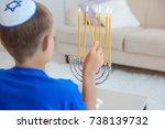 jewish boy lightning menorah at ... | Shutterstock . vector #738139732