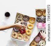 group of hands holding sweeten... | Shutterstock . vector #738140572