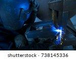 welder working a welding metal  ... | Shutterstock . vector #738145336