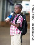 small schoolboy with a backpack ... | Shutterstock . vector #738149878