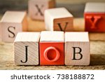 Stock photo job the word job with wooden letters on a wooden background 738188872