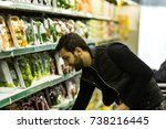 young man buying products at... | Shutterstock . vector #738216445