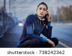 young woman sitting on street... | Shutterstock . vector #738242362