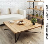 modern wooden table in the loft ... | Shutterstock . vector #738246535