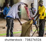 Small photo of 2017 Sept 17:Kaloka Beach, Kisumu County, Lake Victoria, Kenya.Fish buyer and fisherman,at local Fish Banda,are placing African Lungfish into hessian sack, in preparation for weighing.Morning's catch.