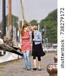 women walking on a pier | Shutterstock . vector #738279172