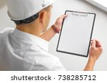 mockup. the chief builder holds ... | Shutterstock . vector #738285712