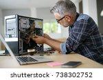 technician repairing computer... | Shutterstock . vector #738302752