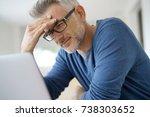 man at home having a headache... | Shutterstock . vector #738303652