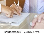 businessman holding the pen and ... | Shutterstock . vector #738324796