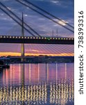 Small photo of Belgrade panorama New Railway and Ada bridges Sava River after sunset detail, colorful lights reflection on water