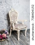 Small photo of Old fashioned interior with luxury armchair on ocher wallpaper background