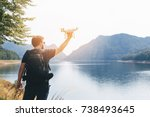 man is holding white drone near ... | Shutterstock . vector #738493645
