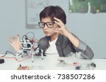 a small nerd in glasses is... | Shutterstock . vector #738507286