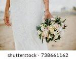 bride holding her bridal... | Shutterstock . vector #738661162